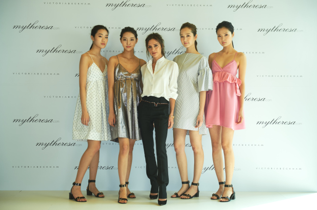 Victoria Beckham (third from left) poses with Korean models wearing four dresses she designed for domestic customers at Four Seasons Hotel in Seoul on Monday. (mytheresa.com)