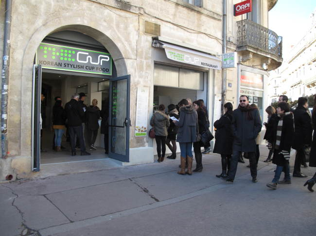 Customers queue in front of The Cup in Montpellier, France. (Yonhap)