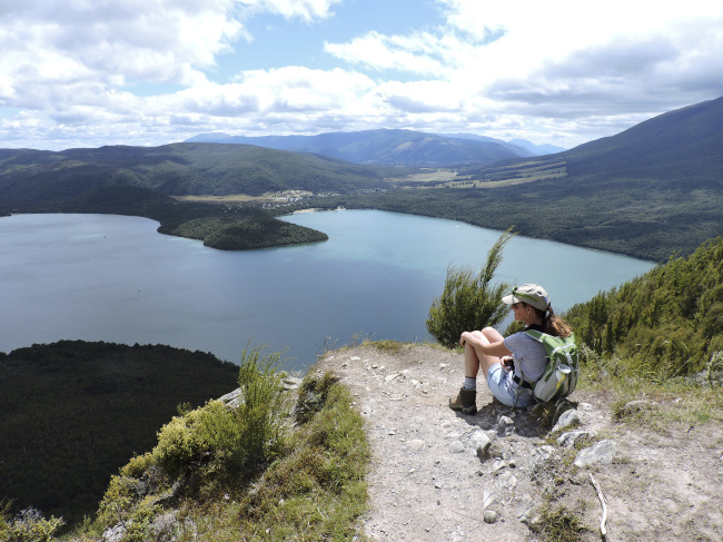 A hiker enjoys the view of Lake Rotoiti near the top of Mount Roberts in New Zealand. (Orange County Register/TNS)