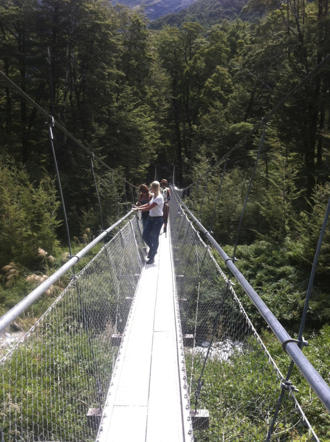 Many popular trails feature substantial maintenance and development, like this suspension bridge on the Routeburn Track in New Zealand. (Orange County Register/TNS)