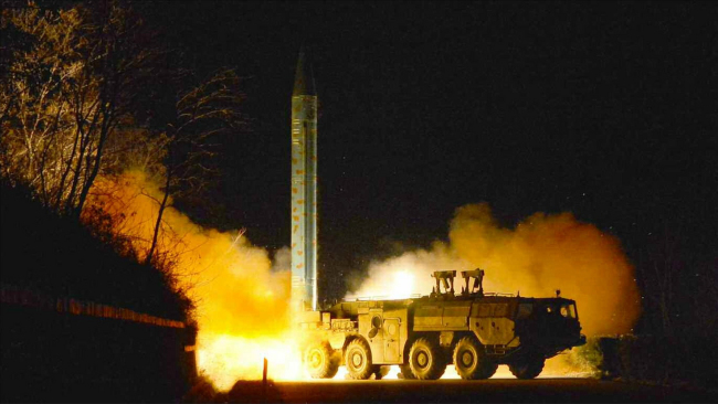 A picture released by North Korea's main newspaper Rodong Shinmun on March 11, claiming the short-range ballistic missile launch test. (Yonhap)