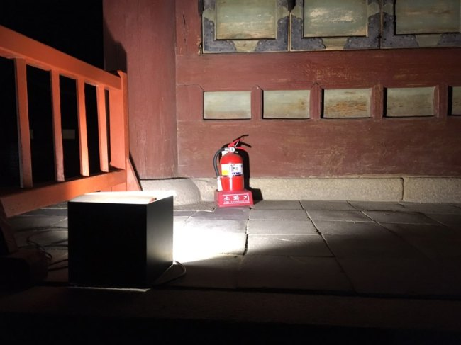 A fire extinguisher is placed next to the building at Gyeongbokgung Palace. Kim Da-sol/The Korea Herald