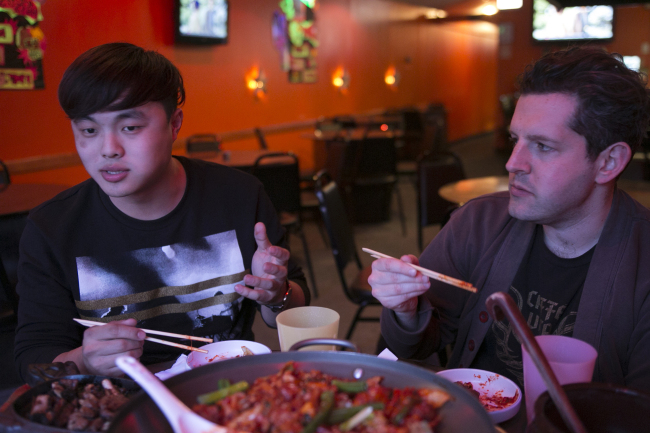 "Deuki Hong (left) and Matt Rodbard, authors of the cookbook ""Koreatown,"" talk over dinner at Dancen in Chicago's Lincoln Square neighborhood. (Chicago Tribune/TNS)"