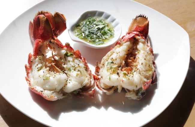 Broiled lobster tails with fresh herb and chive glaze. (Regina H. Boone/ Detroit Free Press/TNS)