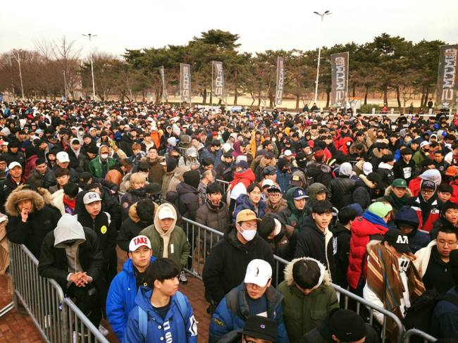 Participants stand in line for hours during the preliminary for