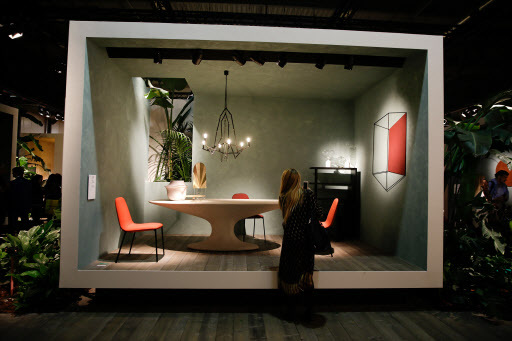 A woman views an exposition at the Zanotta space, as part of the design fair, in Rho, near Milan, Italy. (AP-Yonhap)