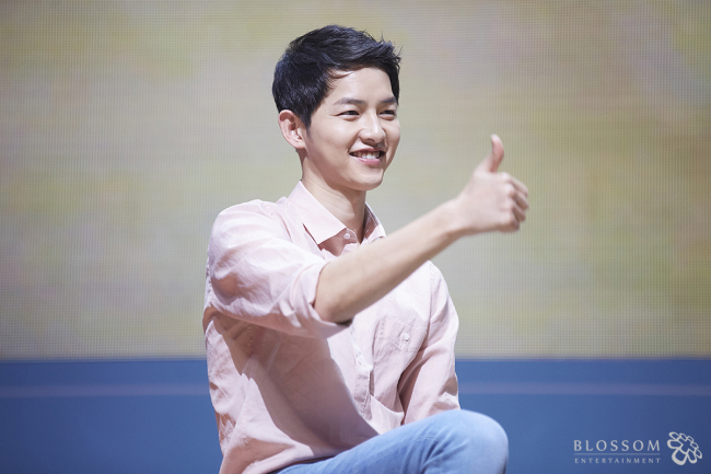 Song Joong-ki speaks at a fan meeting in Seoul on April 18. (Blossom Entertainment)