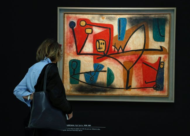 "A visitor watches ""High Spirits"", a mixed media painting by German artist Paul Klee, during a press preview at the Georges Pompidou Cultural and Art Center on April 5, in Paris. (AFP-Yonhap)"
