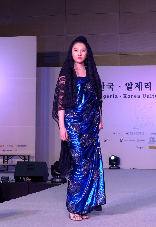 A model showcases a newly interpreted traditional dress by Algerian designer Samir Kerzabi on stage at Coex in Seoul on Thursday. (Joel Lee / The Korea Herald)