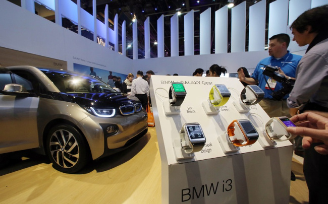 BMW's i3 compact that can be controlled by Samsung's smartwatch Gear S2 is displayed at an exhibition booth during the Consumer Electronics Show in Las Vegas in January. Samsung Electronics