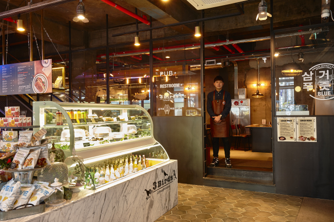 An interior view of YG Entertainment's 3 Birds cafe in Myeong-dong. (YG Entertainment)