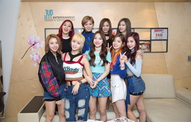Girl group Twice's Tzuyu (top, second left) was mired in a scandal involving China-Taiwan relations in January. (JYP Entertainment)