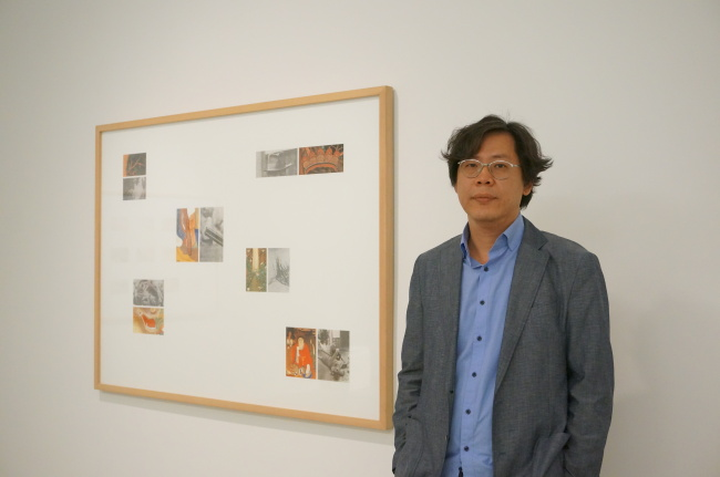Park Chan-kyong poses with his work at Tina Kim Gallery in New York on May 5. (Lee Woo-young/The Korea Herald)