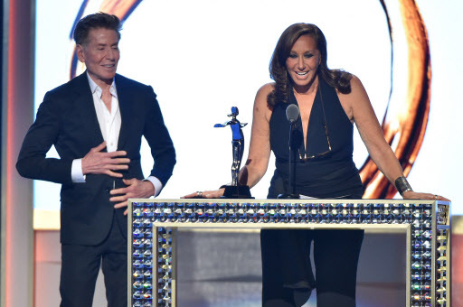 Designer Calvin Klein presents designer Donna Karan with The Founders Award In Honor of Eleanor Lambert at the 2016 CFDA Fashion Awards at the Hammerstein Ballroom on Monday in New York City. (AFP-Yonhap)