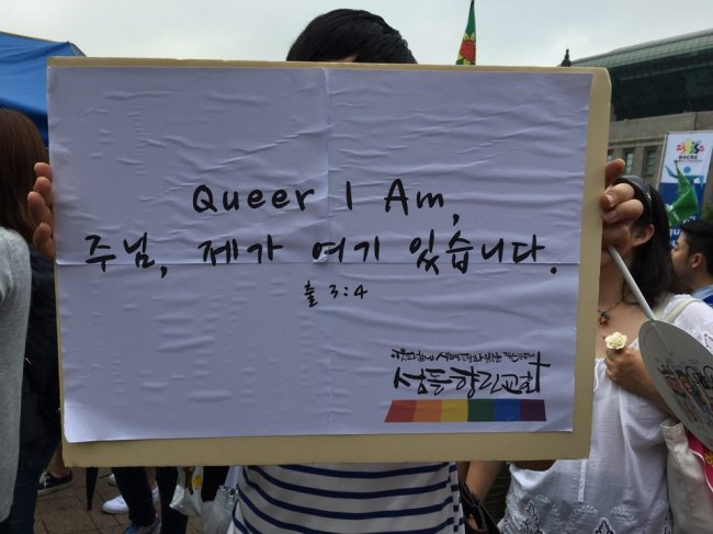 Kim Jeong Woong-Ki, a church-goer, holds up a placard reading