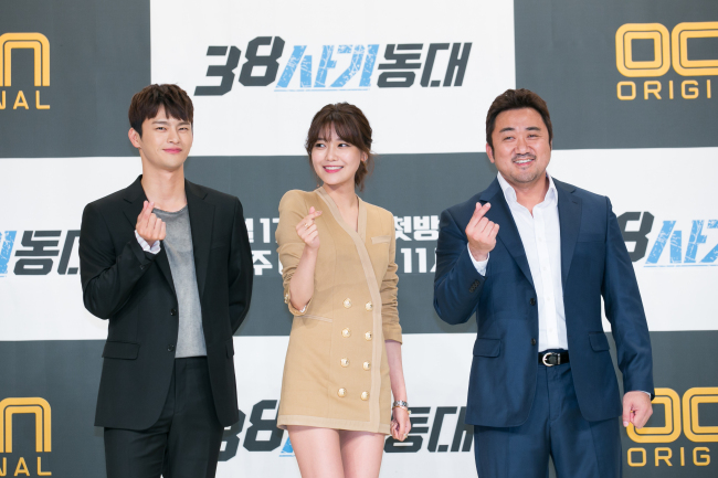 "From left: Seo In-guk, Choi Soo-young and Ma Dong-seok pose at a press conference for OCN series ""Squad 38"" at Yeongdeungpo Times Square on Wednesday. (CJ E&M)"