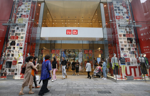 Shoppers enter Uniqlo's flagship store in Tokyo's Ginza shopping district on June 9. (AP-Yonhap)