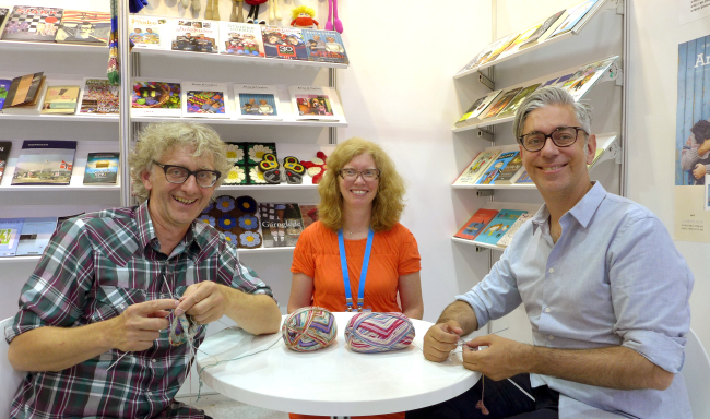 Norwegian book specialist Andrine Pollen (center) and knitwear designers Arne Nerjordet (left) and Carlos Zachrison pose at the Seoul International Book Fair 2016 at Coex in Seoul. (Joel Lee / The Korea Herald)