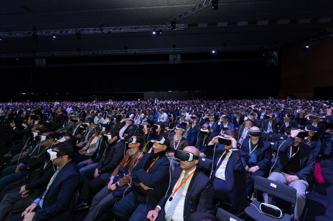 Journalists and industry figures try on Samsung's Gear VR at a launch event of the Galaxy S7 held in Barcelona in February. Samsung Electronics