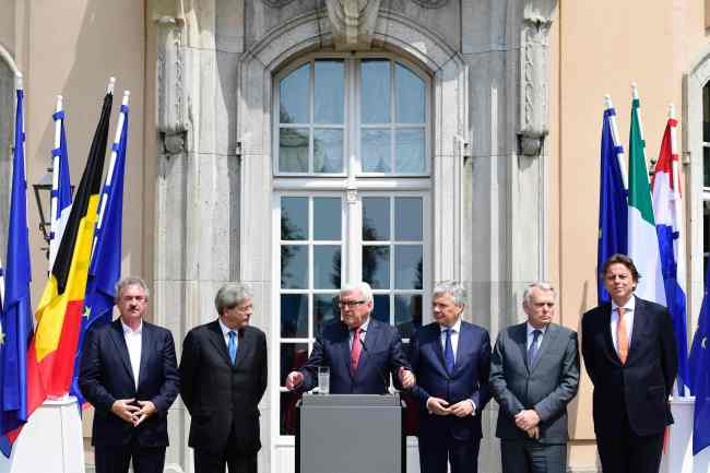 The Foreign Ministers from EU's founding six Jean Asselborn from Luxemburg, Paolo Gentiloni from Italy, Frank-Walter Steinmeier from Germany, Didier Reynders from Belgium, Jean-Marc Ayrault from France and Bert Koenders from the Netherlands, brief the media after a meeting on the so-called Brexit in Berlin, Germany, Saturday, June 25, 2016. (AP Photo/Markus Schreiber)
