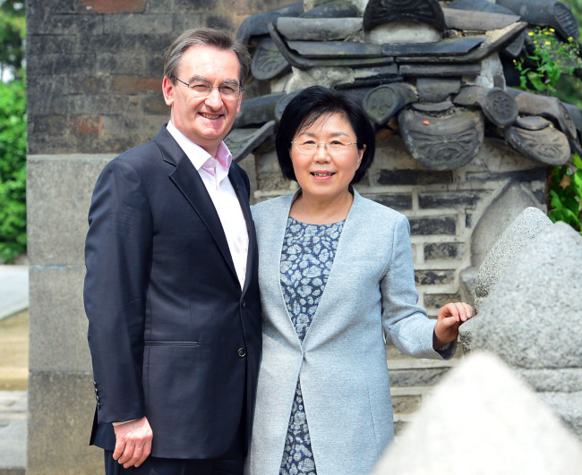 Founder and president of Corea Image Communications Institute Choi Jung-wha (right) and her husband Didier Beltoise, president and CEO of Cs, pose during an interview with The Korea Herald on Thursday at the Westin Chosun Seoul. (Yoon Byung-chan/The Korea Herald)