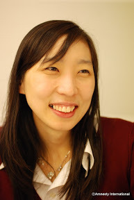 Catherine Heejin Kim, Amnesty International Director.