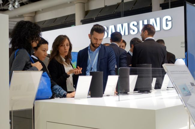 Participants in the Samsung Europe Forum, a showcase event held in Monaco in February, look at the firm's 3-D audio systems. Samsung Electronics