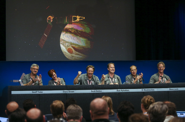 From left to right, Goeff Yoder, Diane Brown, Scott Bolton, Rick Nybakken, Guy Beutelschies, and Steve Levin participate in a post-orbit insertion briefing at NASA's Jet Propulsion Laboratory following the solar-powered Juno spacecraft entered orbit around Jupiter on Monday, July 4, 2016 in Pasadena, Calif. (AP Photo)