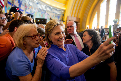 Democratic presidential candidate Hillary Clinton takes a photo with a member of the audience following a rally at the Cincinnati Museum Center at Union Terminal in Cincinnati on June 27. (AP-Yonhap)