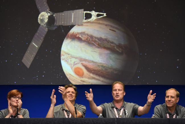 (From left) Diane Brown, NASA Juno program executive, Scott Bolton, Juno principal investigator, Juno Project manager Rick Nybakken and Guy Beutelschies, Lockheed Martin director of space exploration, celebrate at a press conference after the Juno spacecraft was successfully placed into Jupiter's orbit, at the Jet Propulsion Laboratory in Pasadena, California on July 4, 2016.
