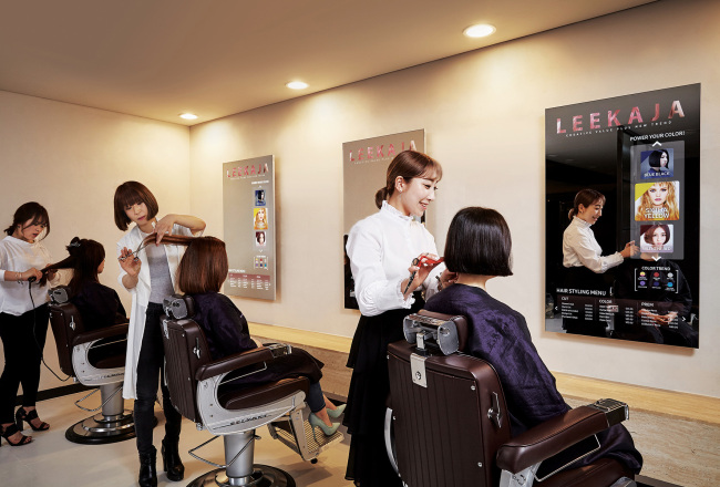 Samsung Display`s futuristic mirror display is installed at a hair shop in Seoul.