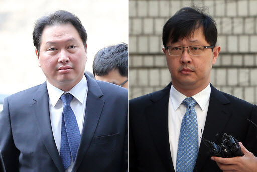 SK Group chariman Chey Tae-won (left) and vice chairman Chey Jae-won. The chairman was pardoned in 2015, his brother, the vice chairman, remains in custody serving a 3 1/2-year term.