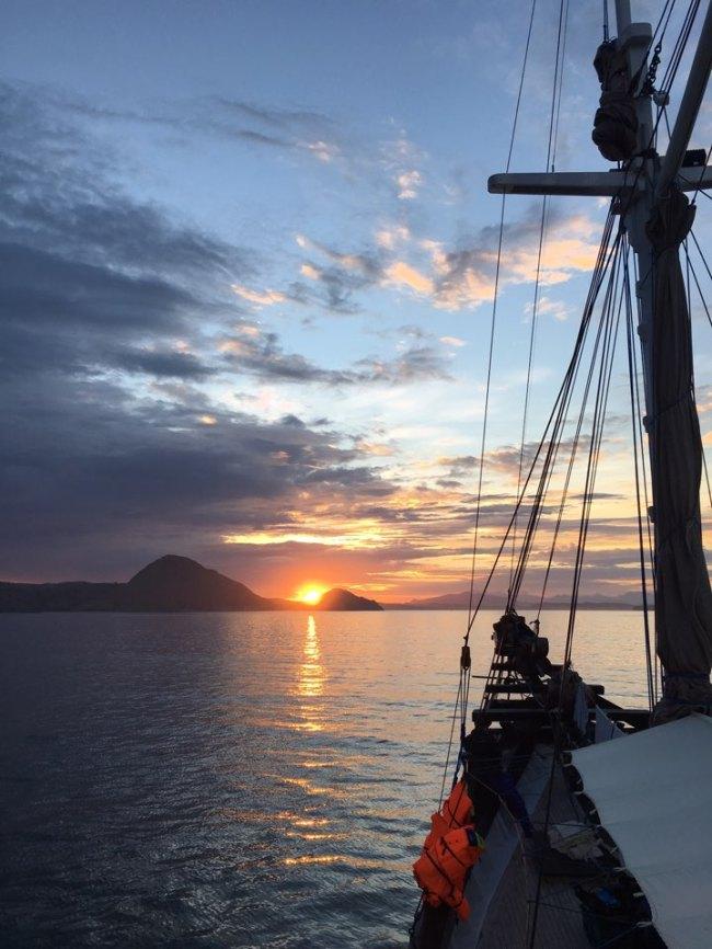 A cruise ship sails through the sea around Labuan Bajo, Indonesia, at sunset. (Ock Hyun-ju/The Korea Herald)