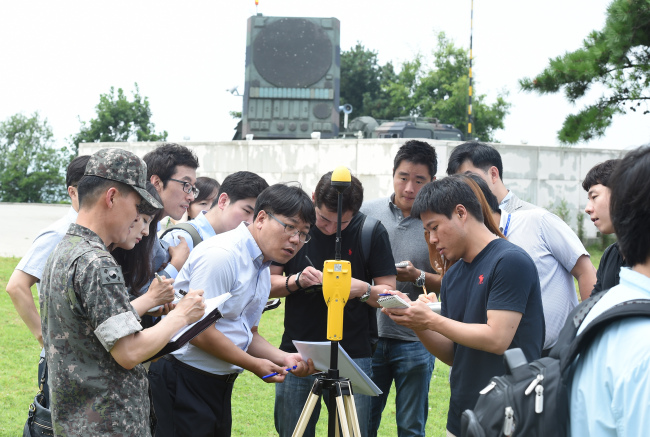 Officials measure the amount of electromagnetic exposure from PAC-2 radar to the press on Thursday. (Defense Ministry)