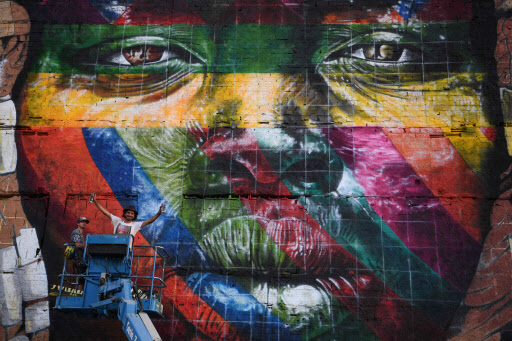 Assistants of Brazilian artist Eduardo Kobra work on the painting of a huge mural representing the five continents, at the Olympic Boulevard, in Rio de Janeiro, Brazil, on July 14. (AFP-Yonhap)