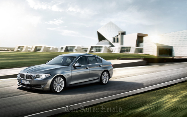 The BMW 520d is cited as one of Korea's most widely used company cars.