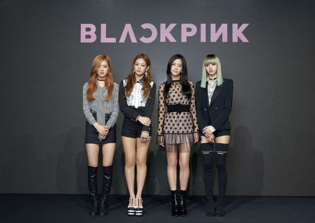From left: Members of YG Entertainment's newest girl group BlackPink -- Rose, Jennie, Jisoo and Lisa -- pose at a press conference in Nonhyeon-dong, Seoul, on Monday (YG Entertainment)