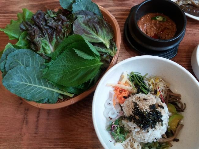 A bowl of barley rice with greens at Jeongtong Babjip (Christine Cho)