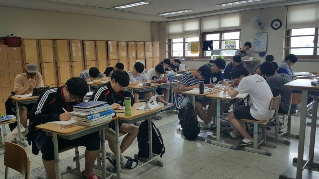 High school seniors students study for the state-administered College Scholastic Ability Test, which is slated for November. Yonhap