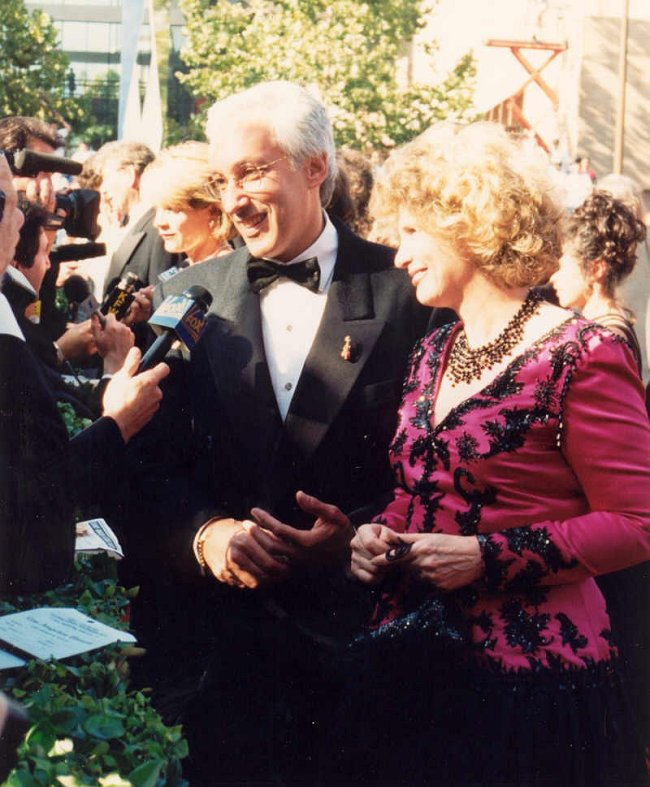 Producer Steven Bochco and wife Barbara Bosson speak on the red carpet at the Emmys in 1994. (Alan Light)