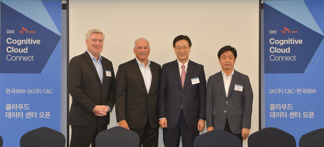 From left: IBM Korea General Manager Jeffrey Rhoda, Robert LeBlanc, Lee Ho-soo and Lee Ki-yeol pose at the press conference held in Seoul on Aug. 25. SK HoldingsC&C