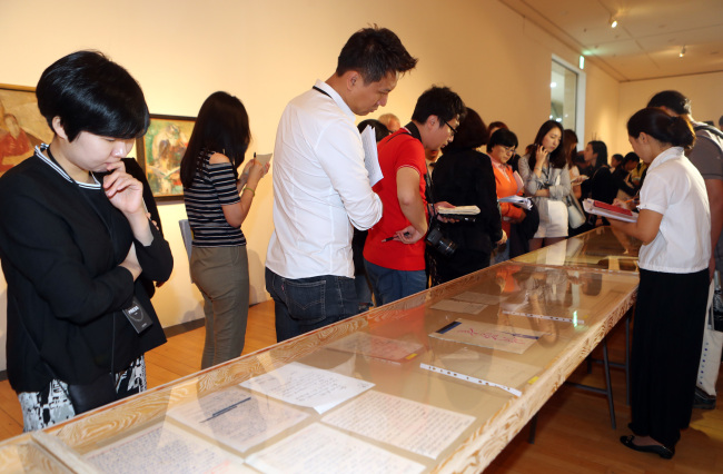 Visitors view the Busan Biennale exhibition during the press opening on Friday in Busan. (Yonhap)