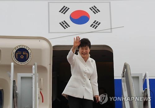 President Park Geun-hye waves as she boards her plane at the military airport in Seongnam, just south of Seoul, on Sept. 2, 2016, to depart for Russia's Far East port city of Vladivostok to attend an economic forum and a summit with her Russian counterpart Vladimir Putin. Park's visit to Russia is part of her eight-day trip that will also takes her to China and Laos.