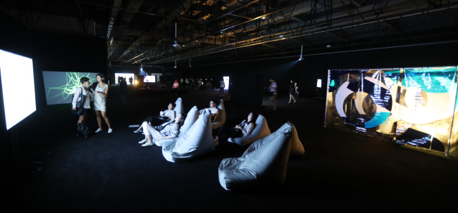 Viewers watch films at the Gallery 2 at the Gwangju Biennale exhibition hall. (Yonhap)