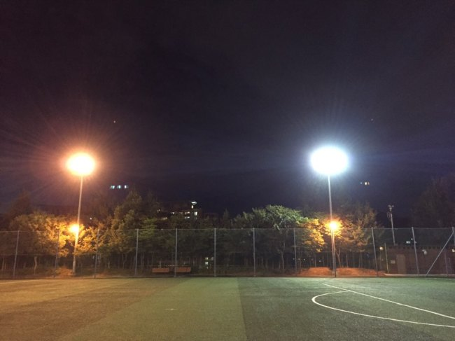 Strong light is emitted from the lights at a public soccer field in Seoul. (Kim Da-sol/The Korea Herald)