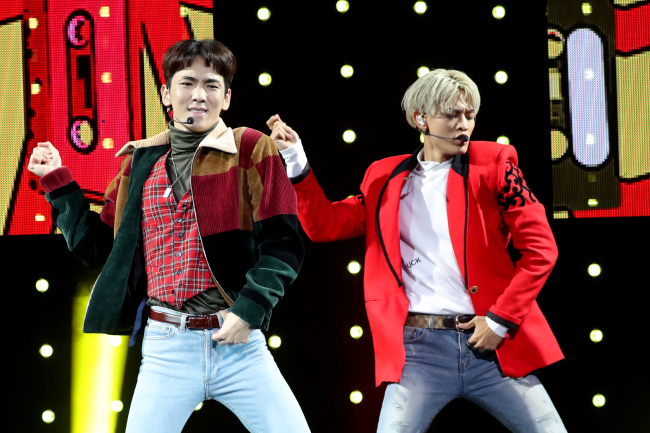 """Key (left) and Minho of K-pop group SHINee dance at a press showcase for the release of the group's fifth album, """"1 of 1,"""" at the SMTOWN Coex Artium in southeastern Seoul on Tuesday afternoon. (Yonhap)"""