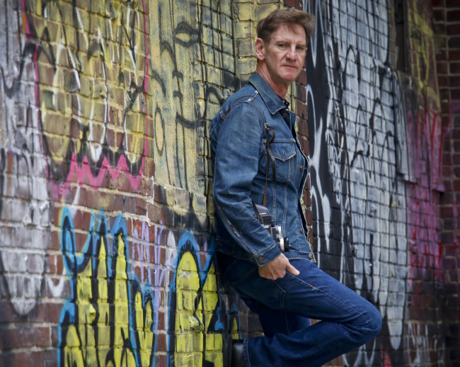 Photographer Mark Seliger poses near the corner of Christopher and Weehawken Streets, in the vicinity of his West Village studio in New York on Sept. 28. (AP-Yonhap)