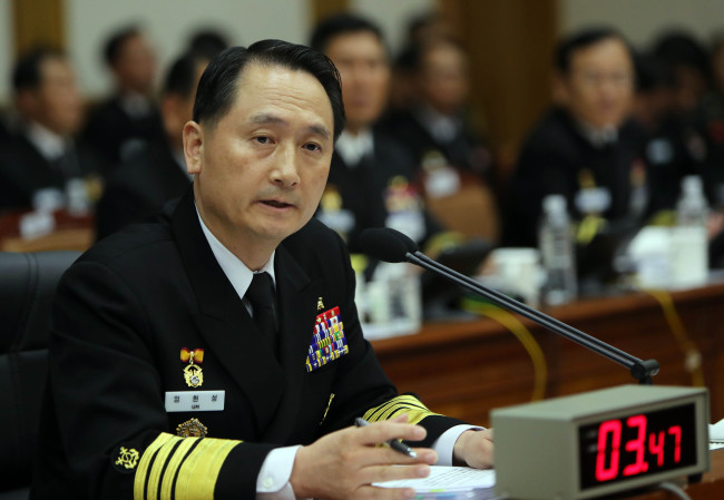 Photo taken on Oct. 11, 2016, Chief of Naval Operations Adm. Um Hyun-seong replies to questions from a lawmaker in a parliamentary hearing held at the Navy's headquarters in South Chungcheong Province. (Yonhap)