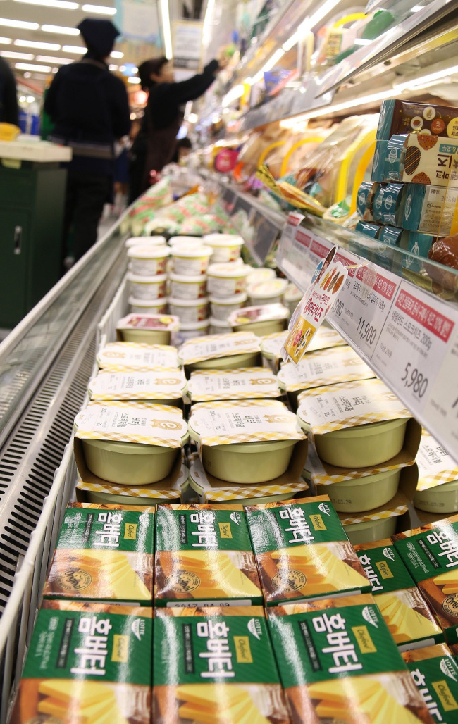 caption: Dairy products are displayed at an E-mart store in Seoul. E-mart