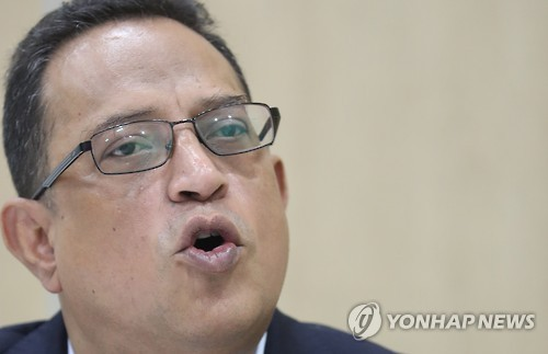 Ata Safdar, head of Oxy Reckitt Benckiser, answers questions regarding its compensation package for the victims of the company's toxic humidifier sterilizer in an interview with Yonhap News Agency on July 31. (Yonhap)